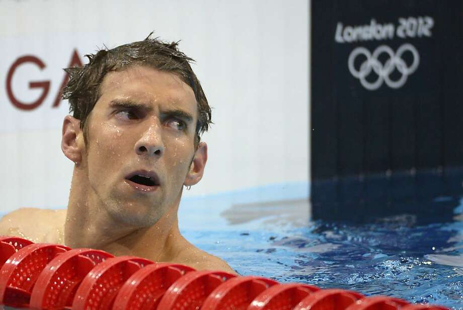United States' Michael Phelps reacts after placing fourth in the men's 400-meter individual medley swimming final at the Aquatics Centre in the Olympic Park during the 2012 Summer Olympics in London, Saturday, July 28, 2012. (AP Photo/Mark J. Terrill) Photo: Mark J. Terrill, Associated Press