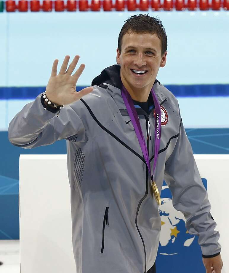 United States' Ryan Lochte wears his gold medal as he waves to spectators after the medal ceremony for men's 400-meter individual medley swimming final at the 2012 Summer Olympics, Saturday, July 28, 2012, in London. (AP Photo/Daniel Ochoa De Olza) Photo: Daniel Ochoa De Olza, Associated Press