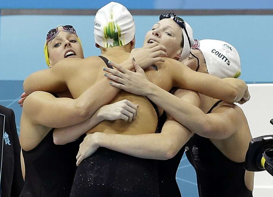 Australia's women's relay team celebrates their gold medal win in the women's 4x100-meter freestyle relay swimming final at the Aquatics Centre in the Olympic Park during the 2012 Summer Olympics in London, Saturday, July 28, 2012. From left: Brittany Elmslie, Melanie Schlanger, Cate Campbell, and Alicia Coutts. (AP Photo/Lee Jin-man) Photo: Lee Jin-man, Associated Press