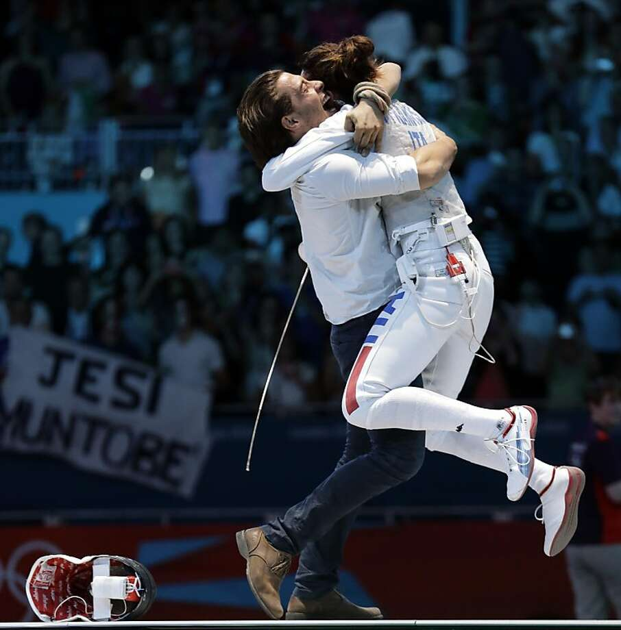 Italy's Elisa Di Francisca reacts after defeating Italy's Arianna Errigo in the gold medal fencing match at the 2012 Summer Olympics, Saturday, July 28, 2012, in London. (AP Photo/Dmitry Lovetsky) Photo: Dmitry Lovetsky, Associated Press