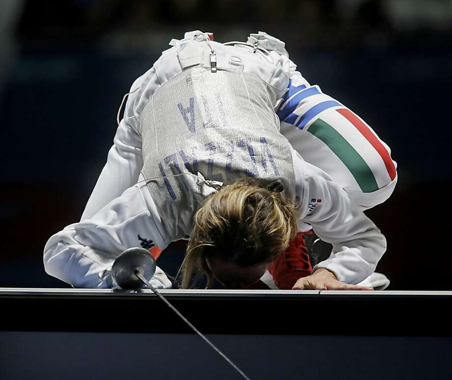 Italy's Valentina Vezzali kisses the ground after defeating South Korea's Nam Hyun-hee during the bronze medal fencing match at the 2012 Summer Olympics, Saturday, July 28, 2012, in London.(AP Photo/Dmitry Lovetsky) Photo: Dmitry Lovetsky, Associated Press