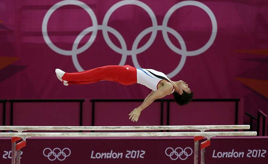 South Korean gymnast Kim Hee-hoon performs on the parallel bars during the Artistic Gymnastic men's qualification at the 2012 Summer Olympics, Saturday, July 28, 2012, in London. (AP Photo/Julie Jacobson) Photo: Julie Jacobson, Associated Press