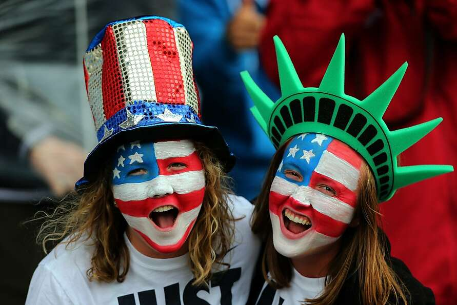GLASGOW, SCOTLAND - JULY 28: USA fans cheer during the Women's Football first round Group G match be
