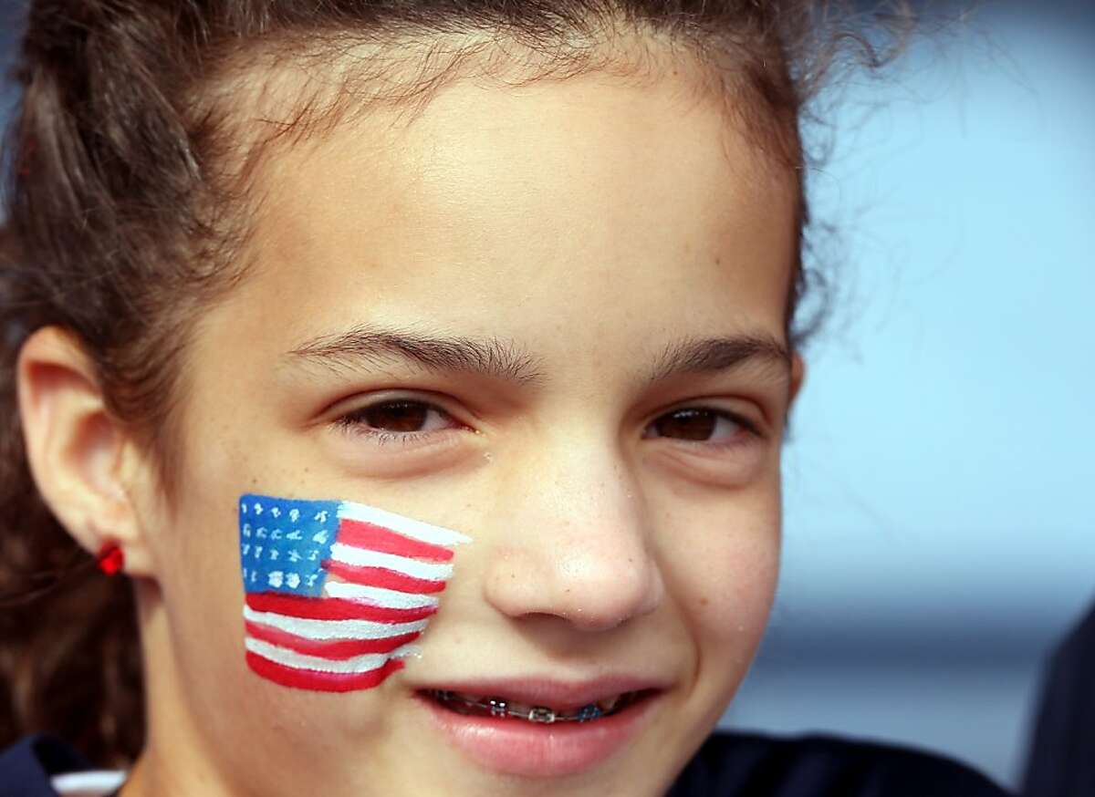 GLASGOW, SCOTLAND - JULY 28: An USA fan wears a painted flag on her face during the Women's Football first round Group G match between United States and Colombia on Day 1 of the London 2012 Olympic Games at Hampden Park on July 28, 2012 in Glasgow, Scotland. (Photo by Stanley Chou/Getty Images)