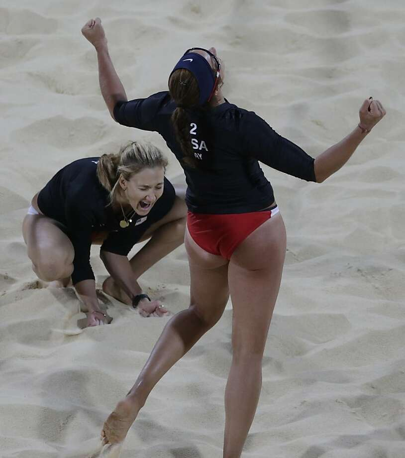 Kerri Walsh, left, of the United States reacts with teammate Misty May-Treanor react after beating Australia during a beach volleyball match at the 2012 Summer Olympics, Saturday, July 28, 2012, in London. (AP Photo/Dave Martin) Photo: Dave Martin, Associated Press