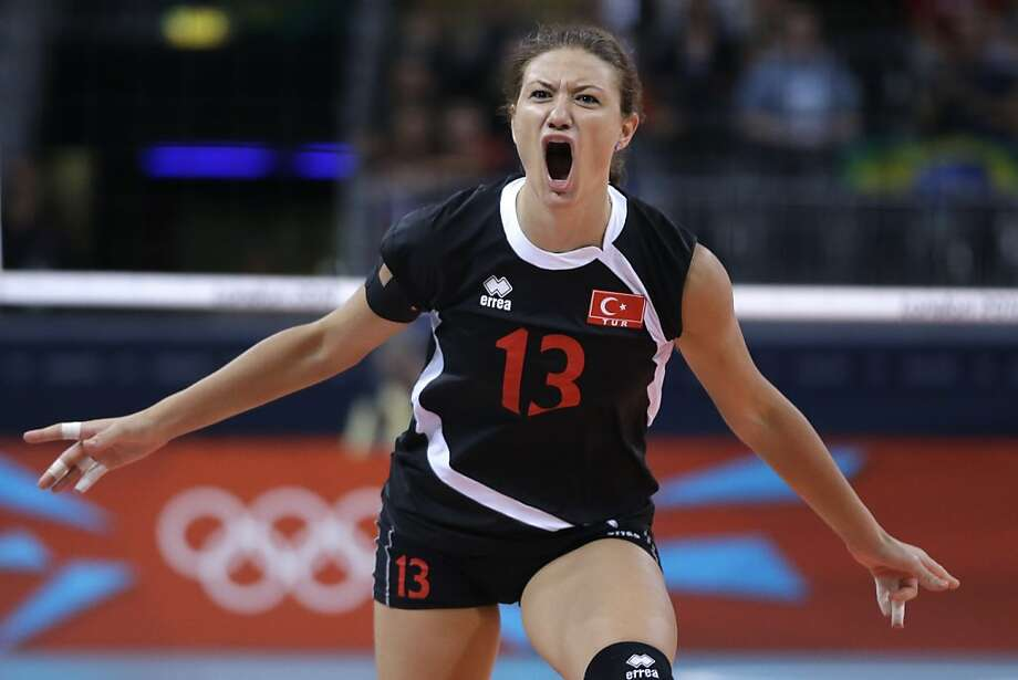 Turkey's Neriman Ozsoy reacts after scoring against Brazil during a women's preliminary volleyball match at the 2012 Summer Olympics, Saturday, July 28, 2012, in London. (AP Photo/Jeff Roberson) Photo: Jeff Roberson, Associated Press
