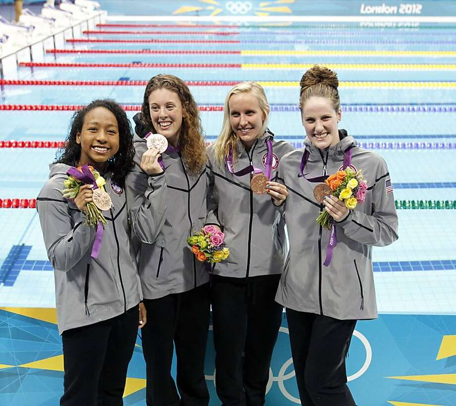 The United States', from left, Lia Neal, Allison Schmitt, Jessica Hardy, and Missy Franklin pose with bronze medals they won in the women's 4x100 freestyle relay during the London 2012 Olympics at the Aquatics Centre on Saturday, July 28, 2012 in London, England. (Vernon Bryant/Dallas Morning News/MCT) Photo: Vernon Bryant, McClatchy-Tribune News Service
