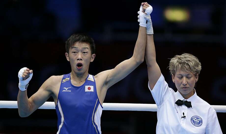 Japan's Satoshi Shimizu reacts after defeating Ghana's Isaac Dogboe in a bantam weight 56-kg preliminary boxing match at the 2012 Summer Olympics, Saturday, July 28, 2012, in London. (AP Photo/Ivan Sekretarev) Photo: Ivan Sekretarev, Associated Press