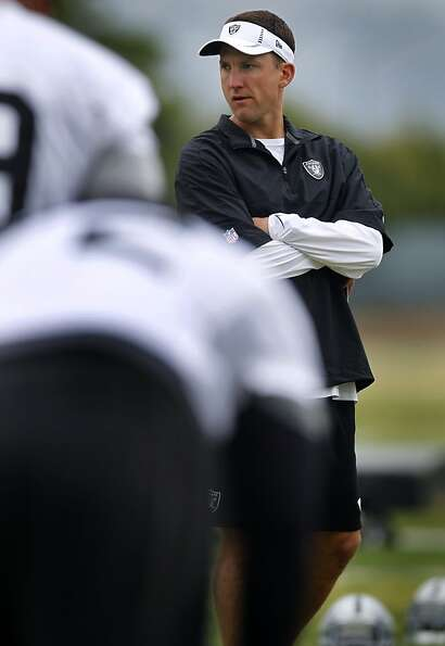 Head Coach Dennis Allen oversees the players' workout at the Oakland Raiders practice facility in Al