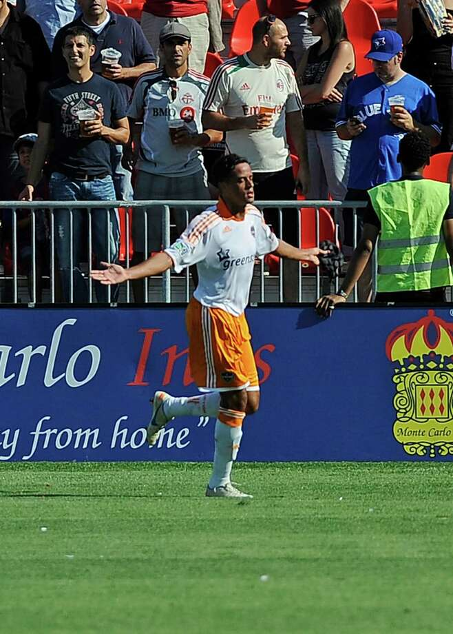 Calen Carr celebrates his first half goal.  Photo: Brad White, Getty Images / 2012 Getty Images