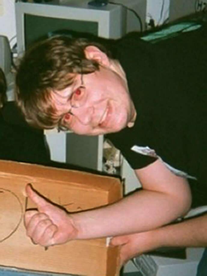 "This image provided by by Mike Cochran shows Neil E. Prescott in an undated photo. Cochran, a friend of Prescott, says the Maryland man accused of threatening to shoot up his workplace is a ""gentle giant"" who collected weapons and had expressed concerns about break-ins near his apartment complex. Cochran tells The Associated Press on Saturday, July 28, 2012, that he thinks Prescott did not intend for his comments to be taken seriously. Cochran says Prescott was known for having a sarcastic sense of humor. (AP Photo/Mike Cochran) Photo: Mike Cochran"
