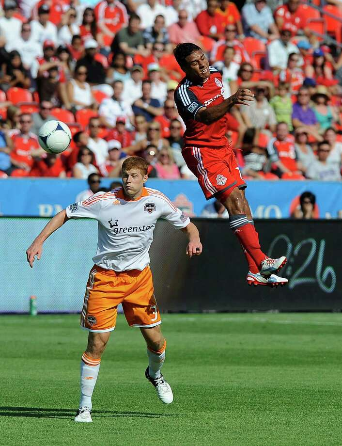 Joao Plata of the Toronto FC heads the ball away from Andre Hainault.  Photo: Brad White, Getty Images / 2012 Getty Images