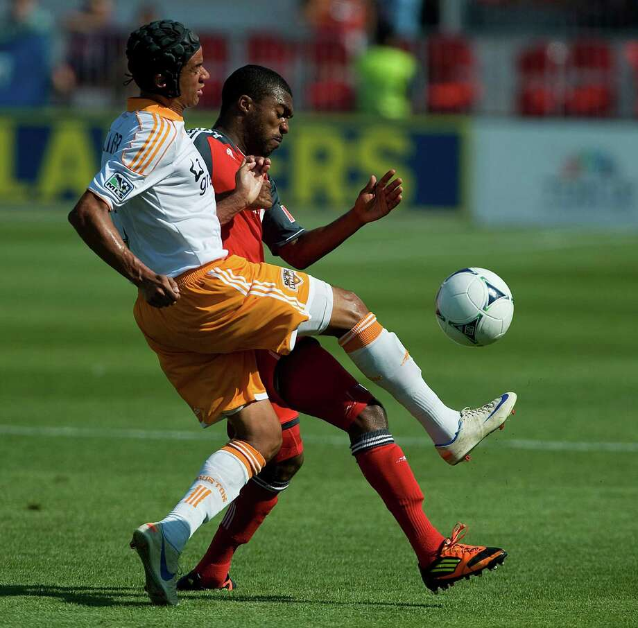 Calen Carr, battles Ashtone Morgan of Toronto FC for the ball. Photo: Aaron Vincent Elkaim, Associated Press / CP