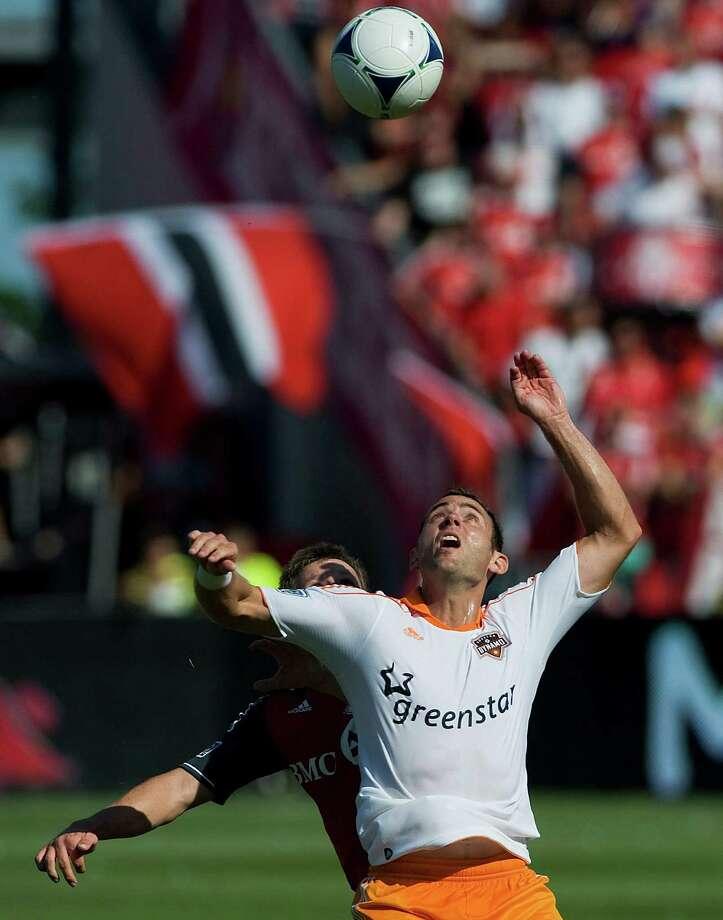 Brad Davis eyes the ball during first half.  Photo: Aaron Vincent Elkaim, Associated Press / CP