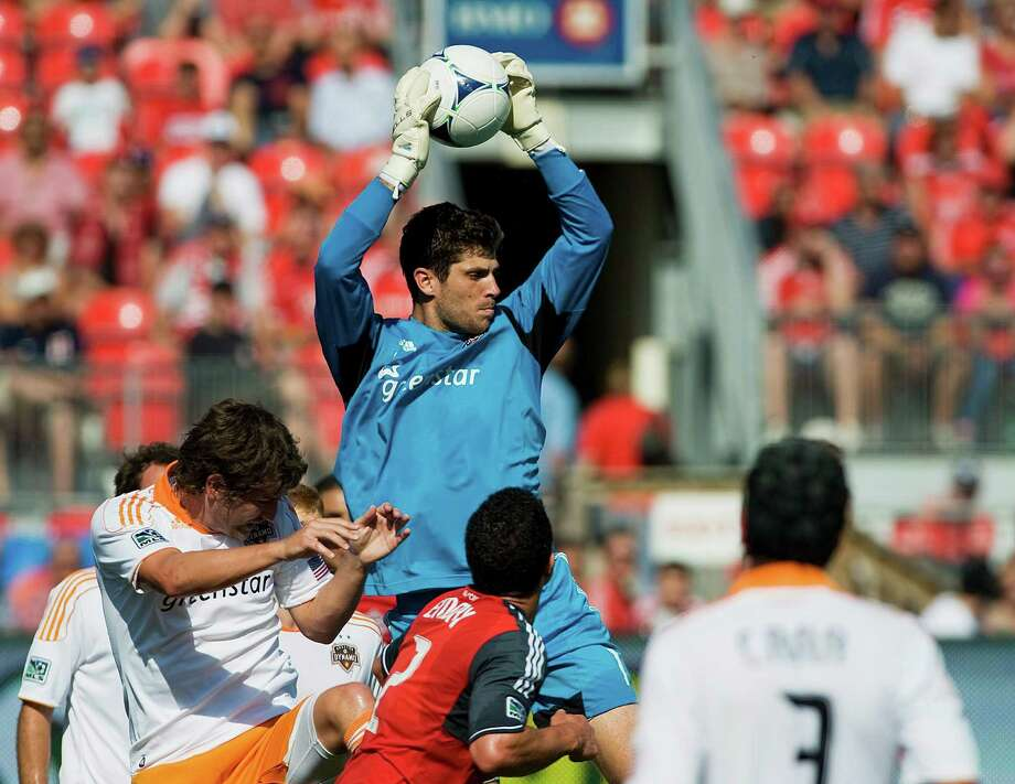 Houston Dynamos goal keeper Tally Hall grabs the ball.  Photo: Aaron Vincent Elkaim, Associated Press / CP