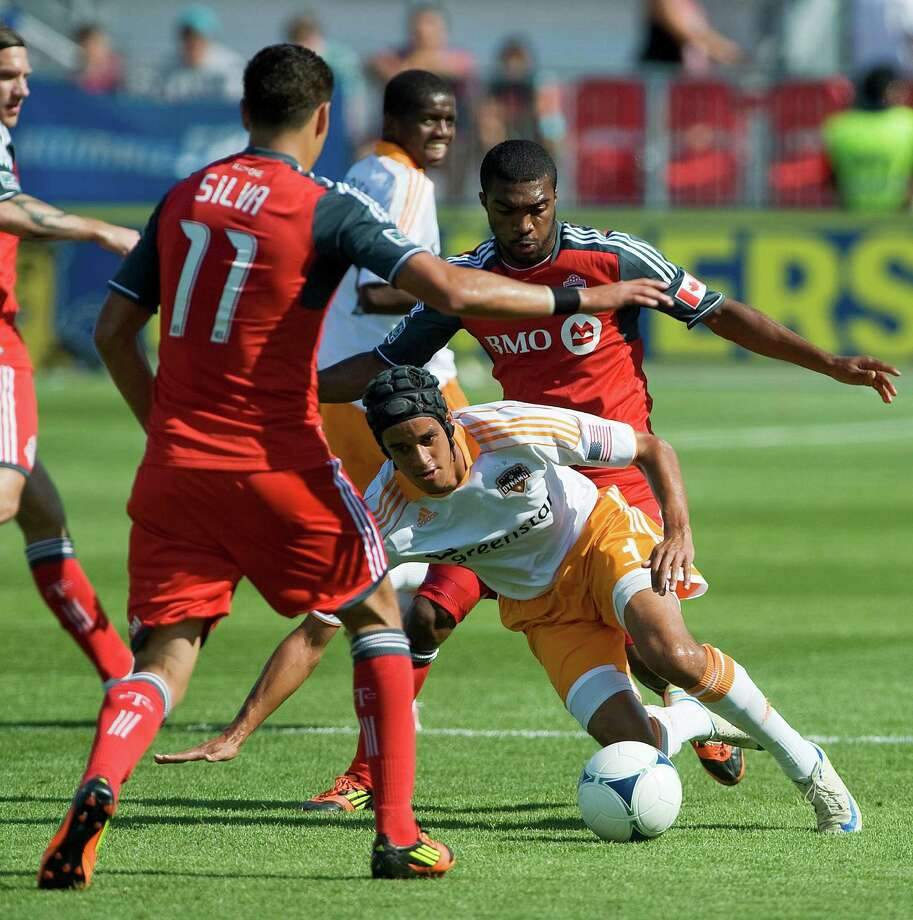 Calen Carr tries to evade Toronto FC Luis Silva.  Photo: Aaron Vincent Elkaim, Associated Press / CP