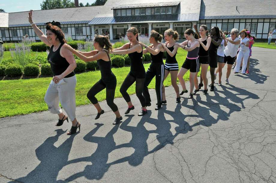 Leslie LaGuardia-Valencia leads a congo line during the National Dance Day at the National Museum of Dance on Sunday July 31, 2011 in Saratoga Springs, NY.  She is Director of the Arthur Murray Dance Center in Saratoga Springs, and is on the Board of Directors of the museum. ( Philip Kamrass / Times Union) Photo: Philip Kamrass / 10014072A