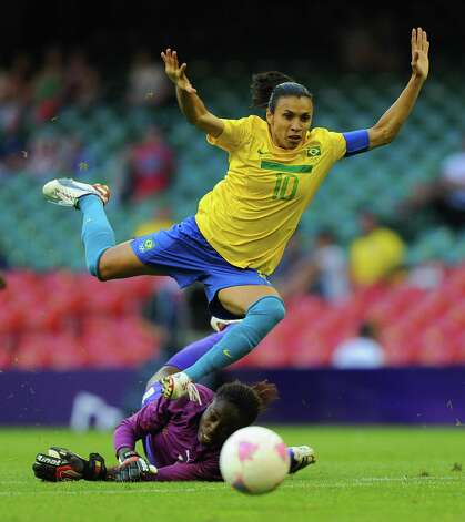 CARDIFF, WALES - JULY 25: Marta of Brazil in action with goalkeeper Annette Ngo Ndom of Cameroon during the First Round Women's Football Group E Match of the London 2012 Olympic Games between Cameroon and Brazil at Millennium Stadium on July 25, 2012 in Cardiff, Wales.  (Photo by Michael Regan/Getty Images) Photo: Michael Regan, Getty Images / 2012 Getty Images