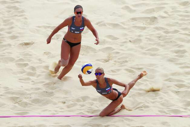 LONDON, ENGLAND - JULY 28: Anastasia Vasina of Russia dips to return the ball during Women's Beach Volleyball match between China and Russia on Day 1 of the London 2012 Olympic Games at Horse Guards Parade on July 28, 2012 in London, England.  (Photo by Ryan Pierse/Getty Images) Photo: Ryan Pierse, Getty Images / 2012 Getty Images