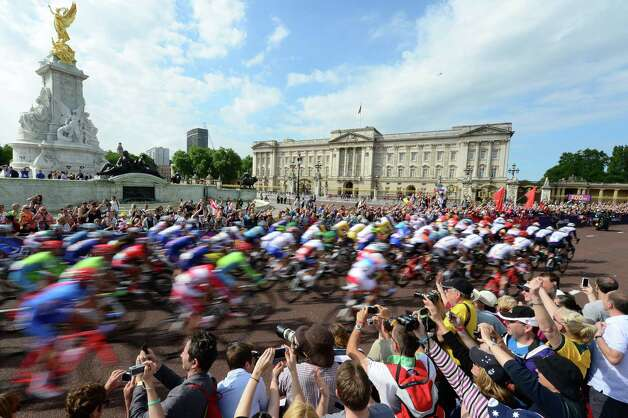 LONDON, ENGLAND - JULY 28:  The peloton passes by Buckingham Palace at the start of the the Men's Road Race Road Cycling on day 1 of the London 2012 Olympic Games on July 28, 2012 in London, England.  (Photo by Jamie Squire/Getty Images) Photo: Jamie Squire, Getty Images / 2012 Getty Images