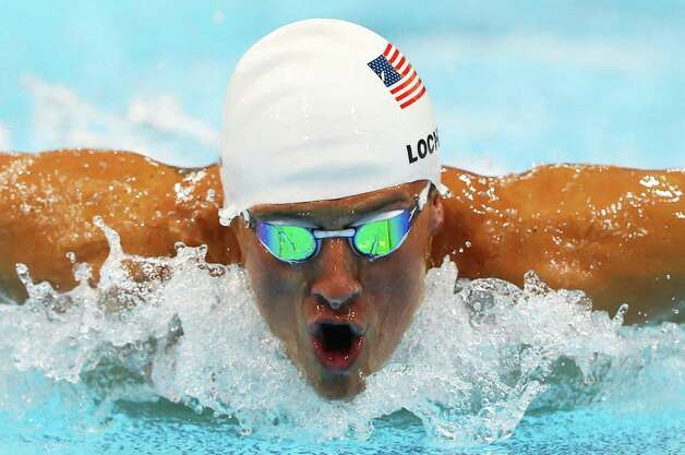 LONDON, ENGLAND - JULY 28:  Ryan Lochte of the United States swims butterfly as he competes in heat five of the Men's 400m Individual Medley on Day One of the London 2012 Olympic Games at the Aquatics Centre on July 28, 2012 in London, England.  (Photo by Al Bello/Getty Images) Photo: Al Bello, Getty Images / 2012 Getty Images