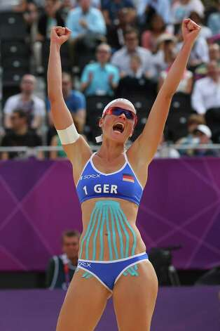 LONDON, ENGLAND - JULY 28:  Katrin Holtwick of Germany celebrates during the Women's Beach Volleyball match between Germany and Czech Republic on Day 1 of the London 2012 Olympic Games at Horse Guards Parade on July 28, 2012 in London, England.  (Photo by Alexander Hassenstein/Getty Images) Photo: Alexander Hassenstein, Getty Images / 2012 Getty Images