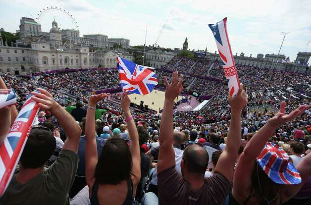 LONDON, ENGLAND - JULY 28:  A general view while fans enjoy the atmosphere on Day 1 of the London 2012 Olympic Games at the Horse Guards Parade on July 28, 2012 in London, England.  (Photo by Alexander Hassenstein/Getty Images) Photo: Alexander Hassenstein, Getty Images / 2012 Getty Images