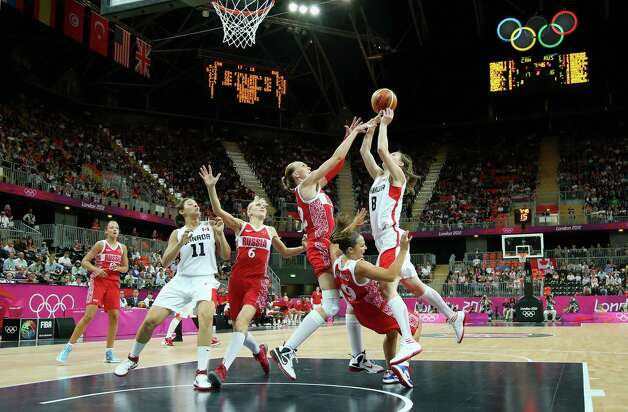 LONDON, ENGLAND - JULY 28:  Kim Smith #8 of Canada shoots against Becky Hammon #9 of Russia and Irina Osipova #12 of Russia during Women's Basketball on day one of the London 2012 Olympic Games at the Basketball Arena on July 28, 2012 in London, England.  (Photo by Christian Petersen/Getty Images) Photo: Christian Petersen, Getty Images / 2012 Getty Images