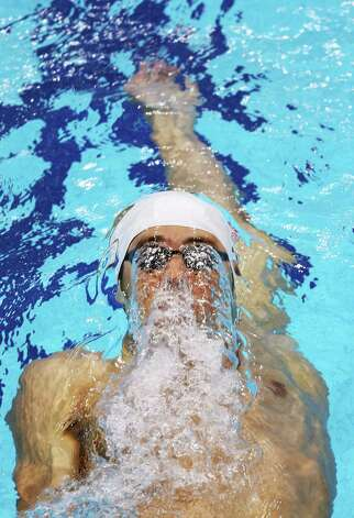 LONDON, ENGLAND - JULY 28:  Michael Phelps of the United States swims backstroke as he competes in heat four of the Men's 400m Individual Medley on Day One of the London 2012 Olympic Games at the Aquatics Centre on July 28, 2012 in London, England.  (Photo by Clive Rose/Getty Images) Photo: Clive Rose, Getty Images / 2012 Getty Images