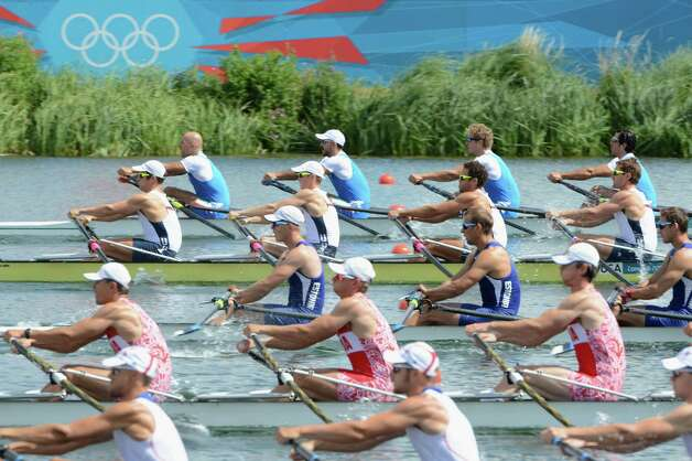 WINDSOR, ENGLAND - JULY 28:  General View of rowers competing in the Men's Quadruple Sculls Heat 1 on Day 1 of the London 2012 Olympic Games at Eton Dorney on July 28, 2012 in Windsor, England.  (Photo by Harry How/Getty Images) Photo: Harry How, Getty Images / 2012 Getty Images