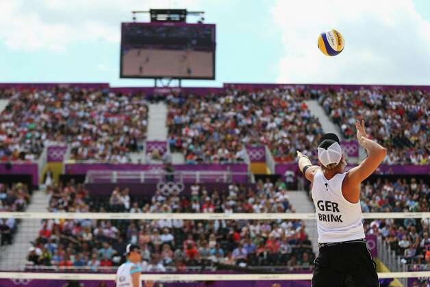LONDON, ENGLAND - JULY 28:  Julius Brink of Germany spikes the ball during the Men's Beach Volleyball match between Germany and Russia on Day 1 of the London 2012 Olympic Games at the Horse Guards Parade on July 28, 2012 in London, England.  (Photo by Ryan Pierse/Getty Images) Photo: Ryan Pierse, Getty Images / 2012 Getty Images