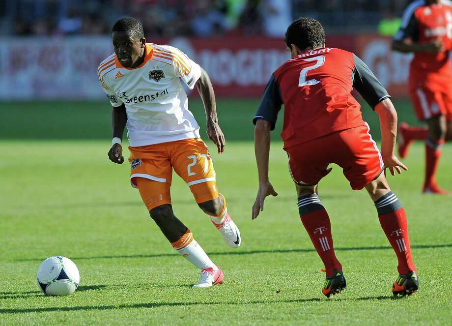 Logan Emory of the Toronto FC defends as Boniek Garcia of the Houston Dynamo dribbles the ball up field. Photo: Brad White, Getty Images / 2012 Getty Images