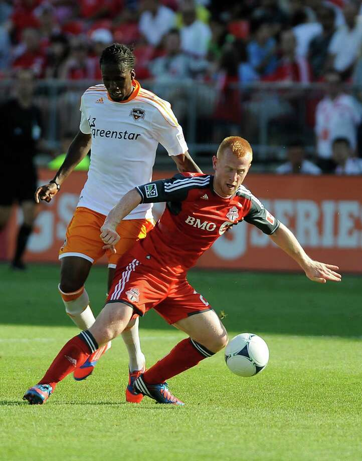 Richard Eckersley of the Toronto FC battles for the ball with Macoumba Kandji. Photo: Brad White, Getty Images / 2012 Getty Images