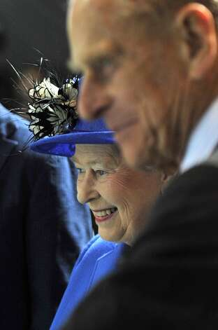 LONDON, UNITED KINGDOM - JULY 28:  Queen Elizabeth II and Prince Philip, Duke of Edinburgh visit the Aquatics Centre during a tour of the Olympic Park on day one of the London 2012 Olympics Games on July 28, 2012 in London, England.  (Photo by Martin Rickett/WPA Pool/Getty Images) Photo: WPA Pool, Getty Images / 2012 Getty Images