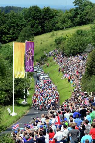 LONDON, ENGLAND - JULY 28:  The peloton make thier way up Box Hill during the Men's Road Race Road Cycling on day 1 of the London 2012 Olympic Games on July 28, 2012 in London, England.  (Photo by Jamie Squire/Getty Images) Photo: Jamie Squire, Getty Images / 2012 Getty Images
