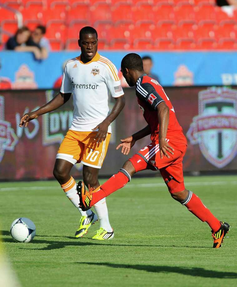 Ashtone Morgan of the Toronto FC battles for the ball with Je-Vaughn Watson. Photo: Brad White, Getty Images / 2012 Getty Images