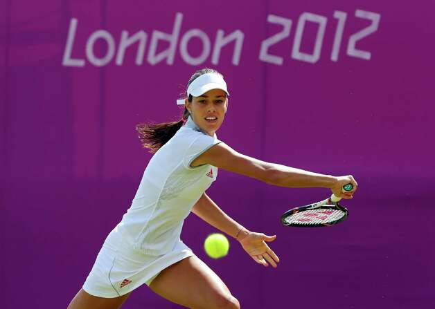 LONDON, ENGLAND - JULY 28:  Ana Ivanovic of Serbia returns a shot against Christina Mchale of the United States during her Women's Singles Tennis match on Day 1 of the London 2012 Olympic Games at the All England Lawn Tennis and Croquet Club in Wimbledon on July 28, 2012 in London, England.  (Photo by Phil Walter/Getty Images) Photo: Phil Walter, Getty Images / 2012 Getty Images