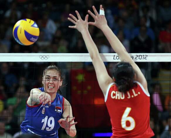 LONDON, ENGLAND - JULY 28:  Sanja Starovic #19 of Serbia returns a shot while Jinling Chu #6 of China defends during the Women's Volleball on Day 1 of the London 2012 Olympic Games at Earls Court on July 28, 2012 in London, England.  (Photo by Elsa/Getty Images) Photo: Elsa, Getty Images / 2012 Getty Images