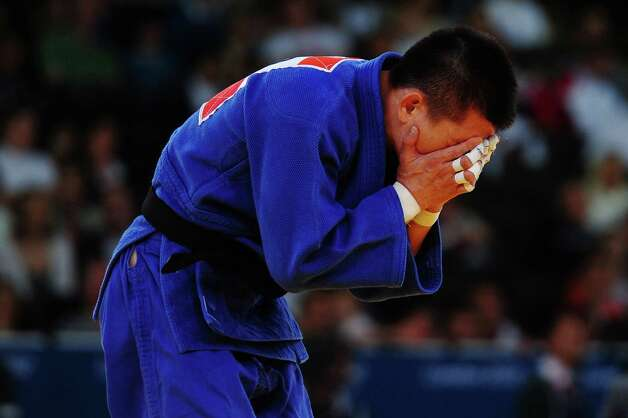 LONDON, ENGLAND - JULY 28:  Gwang-Hyeon Choi of Korea reacts after losing to Arsen Galstyan of Russia in the Men's -60 kg Judo on Day 1 of the London 2012 Olympic Games at ExCeL on July 28, 2012 in London, England.  (Photo by Laurence Griffiths/Getty Images) Photo: Laurence Griffiths, Getty Images / 2012 Getty Images