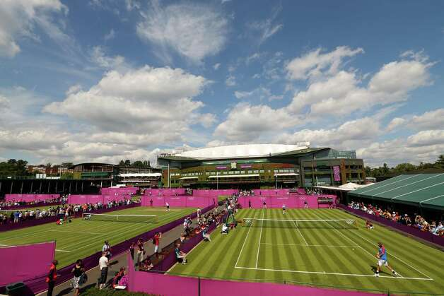 LONDON, ENGLAND - JULY 28:  A general view of play court 10 and 11 on Day 1 of the Tennis during the London 2012 Olympic Games at the All England Lawn Tennis and Croquet Club in Wimbledon on July 28, 2012 in London, England.  (Photo by Clive Brunskill/Getty Images) Photo: Clive Brunskill, Getty Images / 2012 Getty Images