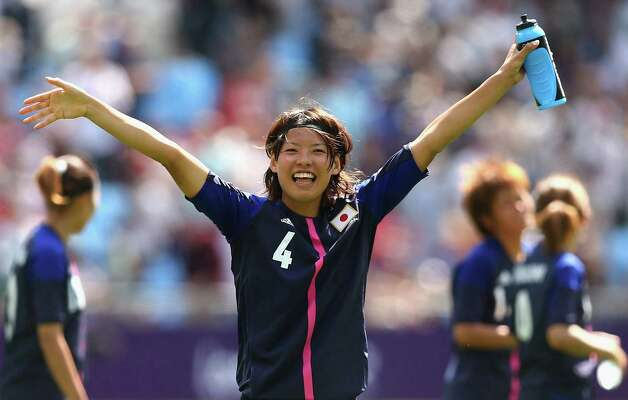 COVENTRY, ENGLAND - JULY 28:  Saki Kumagai of Japan waves to the crowd after playing in the Women's Football first round Group F Match of the London 2012 Olympic Games between Japan and Sweden at City of Coventry Stadium on July 28, 2012 in Coventry, England.  (Photo by Quinn Rooney/Getty Images) Photo: Quinn Rooney, Getty Images / 2012 Getty Images