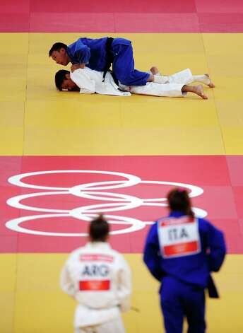 LONDON, ENGLAND - JULY 28:  Judo athletes compete during the Judo on Day 1 of the London 2012 Olympic Games at ExCeL on July 28, 2012 in London, England.  (Photo by Laurence Griffiths/Getty Images) Photo: Laurence Griffiths, Getty Images / 2012 Getty Images