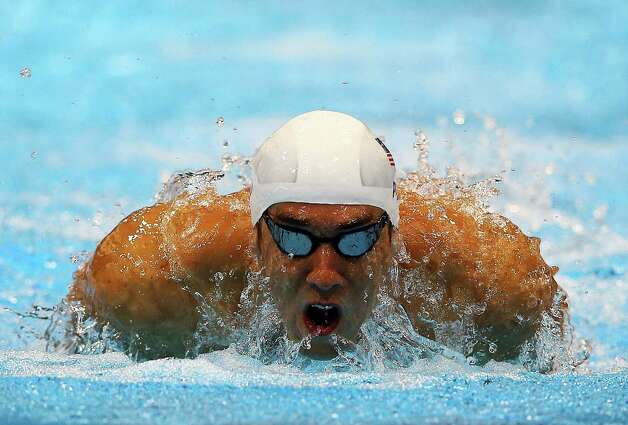 LONDON, ENGLAND - JULY 28:  Michael Phelps of the United States swims butterfly as he competes in heat four of the Men's 400m Individual Medley on Day One of the London 2012 Olympic Games at the Aquatics Centre on July 28, 2012 in London, England.  (Photo by Al Bello/Getty Images) Photo: Al Bello, Getty Images / 2012 Getty Images