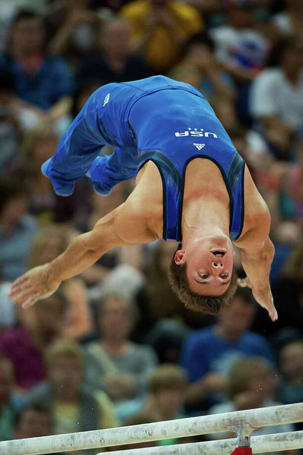 Sam Mikulak of the USA performs on the parallel bars during the men's gymnastics qualifications at the 2012 London Olympics on Saturday, July 28, 2012. Photo: Smiley N. Pool, Houston Chronicle / © 2012  Houston Chronicle