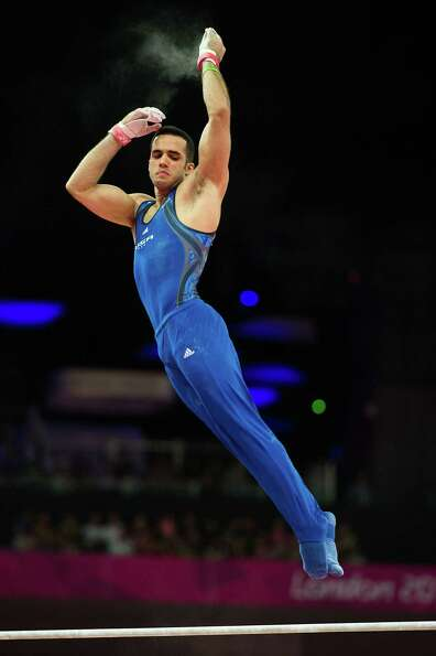 Danell Leyva of the USA performs on the horizontal bars bar during the men's gymnastics qualificatio