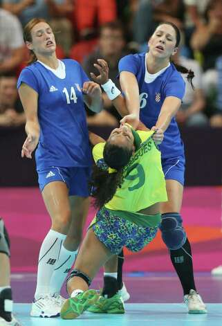 LONDON, ENGLAND - JULY 28:  Ana Paula Rodrigues of Brazil is fouled by Andrea Seric of Croatia in the Women's Handball preliminaries Group A - Match 3 between Croatia and Brazil on Day 1 of the London 2012 Olympic Games at the Copper Box on July 28, 2012 in London, England.  (Photo by Jeff Gross/Getty Images) Photo: Jeff Gross, Getty Images / 2012 Getty Images