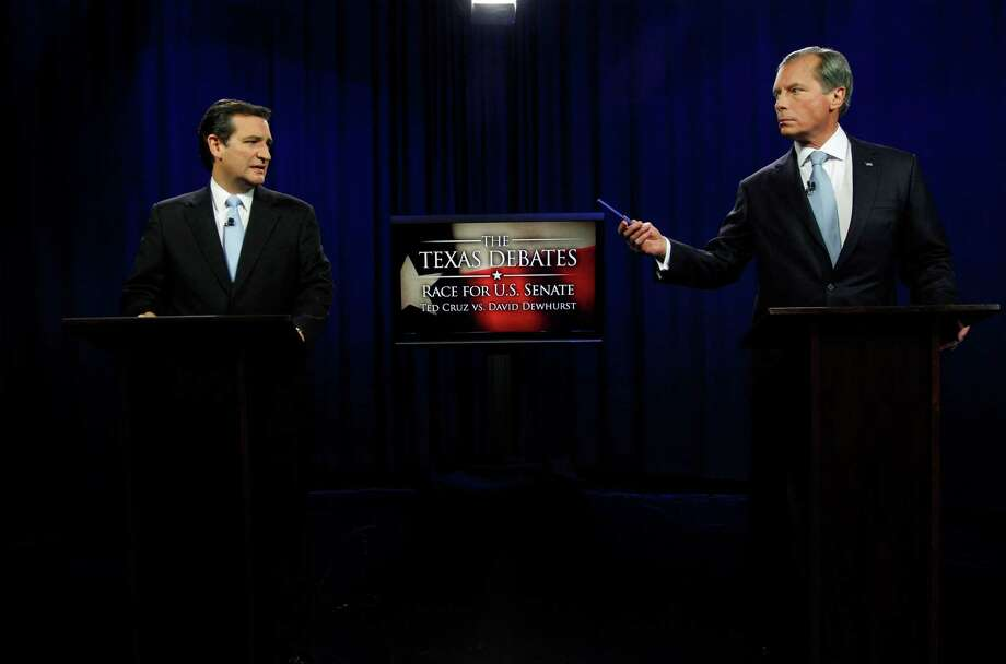U.S. Senate Candidates Ted Cruz, left, and Texas Lt. Gov. David Dewhurst take their places before their televised debate in Dallas, Texas,  Friday, June 22, 2012.  Cruz and Dewhurst are locked in a runoff fight for the Republican nomination to fill Texas' open U.S. Senate seat. Photo: AP