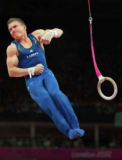Jonathan Horton performs on the still rings during the men's gymnastics qualifications at the 2012 L