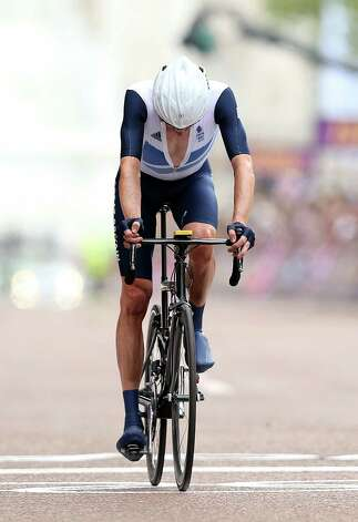 LONDON, ENGLAND - JULY 28:  Bradley Wiggins of Great Britain shows his dejection as he crosses the finish line during the Men's Road Race Road Cycling on day 1 of the London 2012 Olympic Games on July 28, 2012 in London, England.  (Photo by Ezra Shaw/Getty Images) Photo: Ezra Shaw, Getty Images / 2012 Getty Images