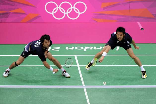 LONDON, ENGLAND - JULY 28:  Shoji Sato (L) and Naoki Kawamae (R) of Japan returns a shot against Boon Heong Tan and Kien Keat Koo of Malaysia during their Men's Doubles Badminton on Day 1 of the London 2012 Olympic Games at Wembley Arena on July 28, 2012 in London, England.  (Photo by Michael Regan/Getty Images) Photo: Michael Regan, Getty Images / 2012 Getty Images